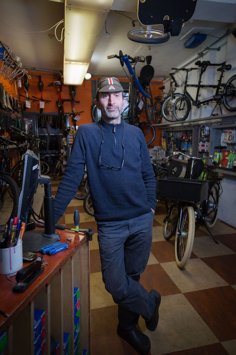 Portrait of a bike shop owner in London Bloomsbury